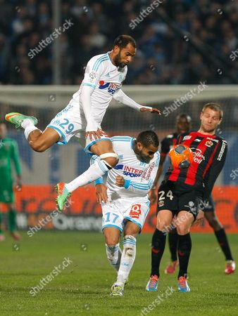 Saber Khalifa, Dimitri Payet, Mathieu Bodmer Marseille's Tunisian forward Saber Khalifa, left, Marseille's French forward Dimitri Payet, center, challenges for the ball with Nice's French defender Mathieu Bodmer, during their League One soccer match, at the Velodrome Stadium, in Marseille, southern France
