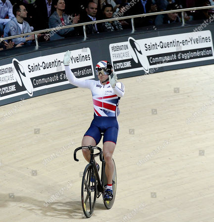 Britain's Jason Kenny celebrates after defeating France's Kevin Sireau in a track cycling men's sprint race during the opening of the Saint Quentin en Yvelines velodrome, outside Paris