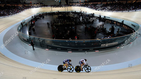 Stock Photo of Britain's Vicky Williamson, right, and France's Sandie Clair compete in a track cycling women's sprint event during the opening of the Saint Quentin en Yvelines velodrome, outside Paris