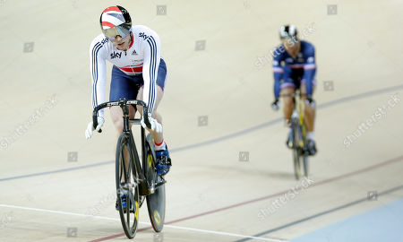 Britain's Jason Kenny, left, and France's Kevin Sireau compete in a track cycling men's sprint race during the opening of the Saint Quentin en Yvelines velodrome, outside Paris