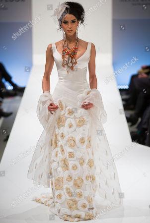 Model Zoe Helali presents a creation of Berlin-based German fashion designer Nanna Kuckuck during the Mercedes Benz Fashion Week in Berlin, Germany