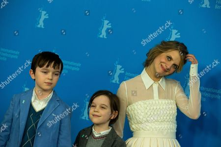 Stock Photo of From left, actors Zen McGrath, Winta McGraph and Melanie Laurent pose for photographers at the photo call for the film Aloft during the International Film Festival Berlinale in Berlin
