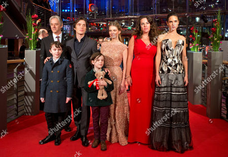 From back left, actors William Shimell, Cillian Murphy, Melanie Laurent, director Claudia Llosa, actors Jennifer Connelly, Zen McGrath, front left, and Winta McGraph, front right, pose for photographers on the red carpet for the film Aloft during the International Film Festival Berlinale in Berlin