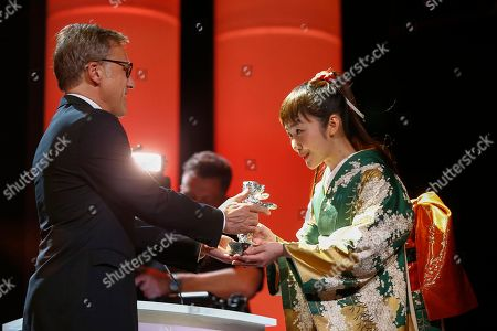 Actress Haru Kuroki, right, receives the Silver Bear as Best Actress for the movie The Little House from Jury member Christoph Waltz during the award ceremony at the International Film Festival Berlinale in Berlin