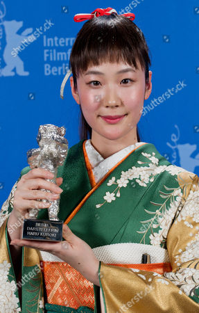 Actress Haru Kuroki shows the Silver Bear as Best Actress for the movie The Little House after the award ceremony at the International Film Festival Berlinale in Berlin