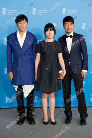 Actors Qin Hao, Zhang Lei and Guo Xiadong pose for photographers at the photo call for the film Blind Massage during the International Film Festival Berlinale in Berlin