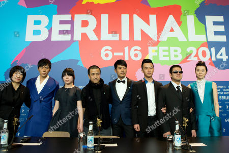 From left, screenwriter Ma Yingli, actors Qin Hao, Zhang Lei, director Lou Ye, actors Guo Xiadong, Huang Xuan, Mu Huaipeng and Lu Huang pose for photographers at the press conference for the film Blind Massage during the International Film Festival Berlinale in Berlin