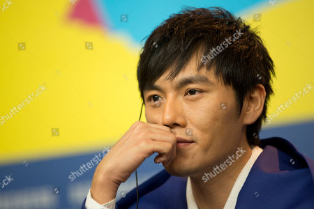 Actor Qin Hao listens to questions from journalists at the press conference for the film Blind Massage during the International Film Festival Berlinale in Berlin