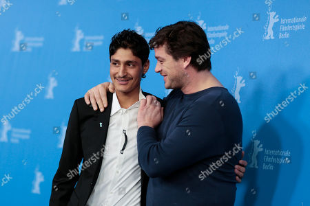 From right, the actors Mohsin Ahmady and Ronald Zehrfeld pose for photographers at the photo call for the film Inbetween Worlds at the Berlinale International Film Festival in Berlin