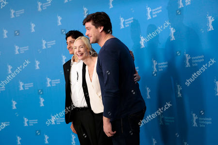 From right, the actors Mohsin Ahmady, director Feo Aladag and Ronald Zehrfeld pose for photographers at the photo call for the film Inbetween Worlds at the Berlinale International Film Festival in Berlin