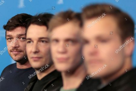 From right, actors Ronald Zehrfeld, Felix Kramer, Pit Bukowski and Tobias Schoenenberg pose for photographers at the photo call for the film Inbetween Worlds at the Berlinale International Film Festival in Berlin