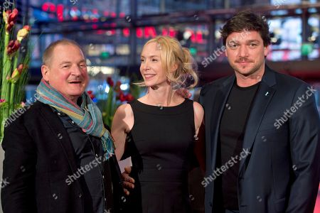 Actor Burghart Klaussner, director Feo Aladag and Ronald Zehrfeld pose for photographers at the red carpet for the film Inbetween Worlds during the International Film Festival Berlinale in Berlin