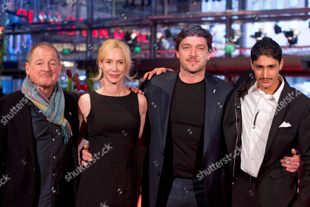 Actor Burghart Klaussner, director Feo Aladag, actors Ronald Zehrfeld and Mohsin Ahmady pose for photographers at the red carpet for the film Inbetween Worlds during the International Film Festival Berlinale in Berlin