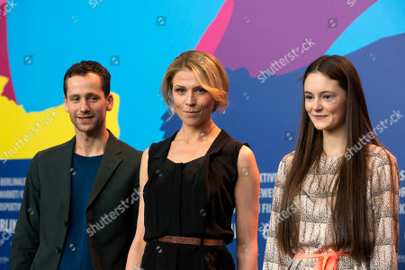 From left, actors Florian Stetter, Franziska Weisz and Lea van Acken pose for photographers at the photo call for the film Station Of The Cross at the International Film Festival Berlinale in Berlin