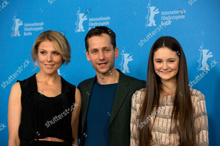 From left, actors Franziska Weisz, Florian Stetter and Lea van Acken pose for photographers at the photo call for the film Station Of The Cross at the International Film Festival Berlinale in Berlin
