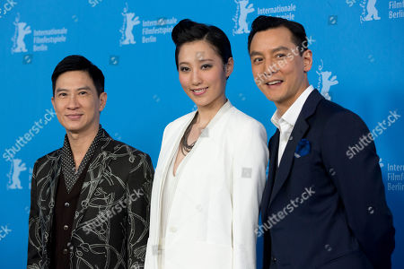 From left, actors Nick Cheung, Christie Chen and Daniel Wu pose for photographers at the photo call for the film That Demon Within (Mo Jing) during the 64th Berlinale International Film Festival,, in Berlin