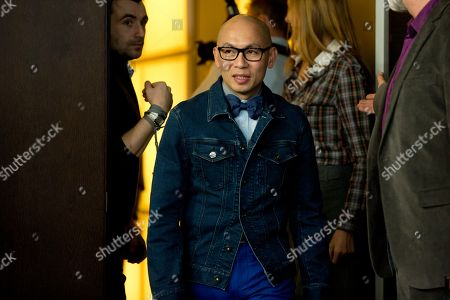Chinese director Dante Lam arrives for the photo call for the film That Demon Within during the 64th Berlinale International Film Festival,, in Berlin