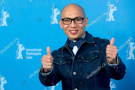 Chinese director Dante Lam poses for photographers at the photo call for the film That Demon Within during the 64th Berlinale International Film Festival,, in Berlin