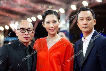 Director Dante Lam and actors Christie Chen and Daniel Wu pose at the red carpet for the film That Demon Within during the 64th Berlinale International Film Festival,, in Berlin