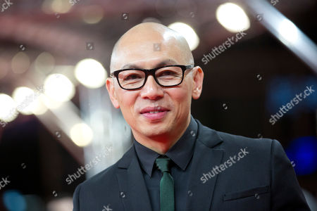 Chinese director Dante Lam poses on the red carpet for the film That Demon Within during the 64th Berlinale International Film Festival,, in Berlin