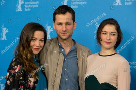 From left, actors Hannah Herzsprung, Florian Stetter and Henriette Confurius pose for photographers at the photo call for the film The Beloved Sisters during the 64th Berlinale International Film Festival,, in Berlin