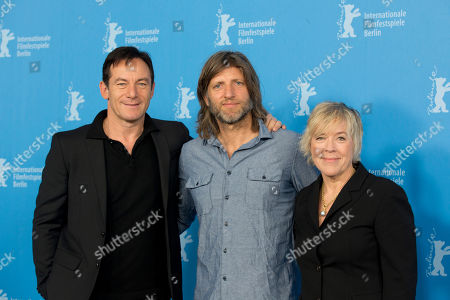 Actor Jason Isaacs, director Saar Klein, and producer Sarah Green pose for photographers at the photo call for the film Things People Do at the International Film Festival Berlinale in Berlin
