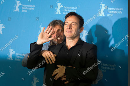 Director Saar Klein, background, embraces actor Jason Isaacs as they pose for photographers at the photo call for the film Things People Do at the International Film Festival Berlinale in Berlin