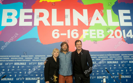Producer Sarah Green, director Saar Klein and actor Jason Isaacs pose for photographers at the press conference for the film Things People Do at the International Film Festival Berlinale in Berlin