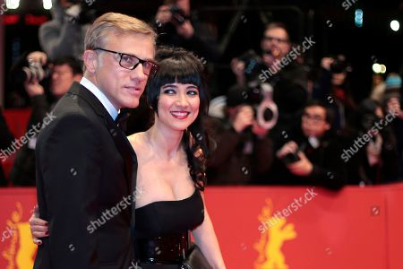 Jury members Christoph Walz and Mitra Farahani arrive on the red carpet for the award ceremony of the International Film Festival Berlinale in Berlin