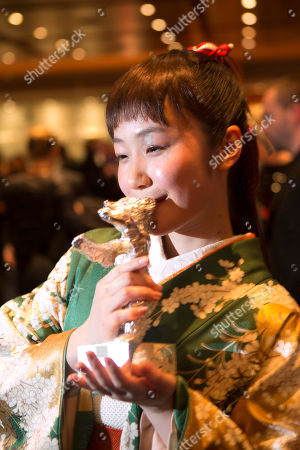 Actress Haru Kuroki shows the Silver Bear she received for Best Actress for the movie The Little House after the award ceremony at the International Film Festival Berlinale in Berlin, award ceremony at the International Film Festival Berlinale in Berlin, Saturday, Feb. 15, 2014