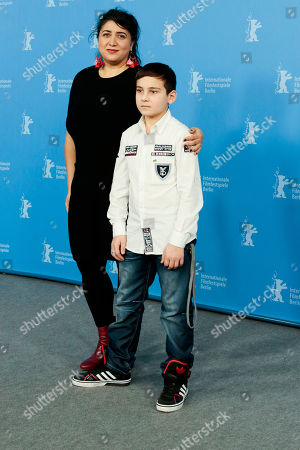Director Sudabeh Mortezai, left, and actor Ramasan Minkailov pose for photographers at the photo call for the film Macondo during the International Film Festival Berlinale in Berlin
