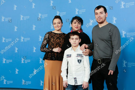 From left, actress Kheda Gazieva, director Sudabeh Mortezai, actor Aslan Elbiev and in front actor Ramasan Minkailov pose for photographers at the photo call for the film Macondo during the International Film Festival Berlinale in Berlin