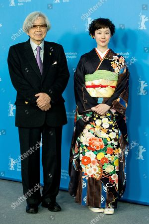 Director Yoji Yamada and actress Haru Kuroki pose for photographers at the photo call for the film The Little House during the International Film Festival Berlinale in Berlin