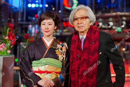 Actress Haru Kuroki and Director Yoji Yamada pose for photographers on the red carpet for the film The Little House during the International Film Festival Berlinale in Berlin
