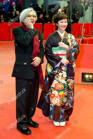 Director Yoji Yamada and actress Haru Kuroki pose for photographers on the red carpet for the film The Little House during the International Film Festival Berlinale in Berlin
