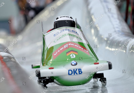 Thomas Florschuetz, front, and Kevin Kuske from Germany speed down the bob run during the two man bob World Cup in Winterberg, Germany, on
