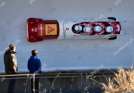 Switzerland's Beat Hefti, Alex Baumann, Juerg Egger and Thomas Amrhein compete in the 4-Man Bobsled World Cup race in Winterberg, Germany, on