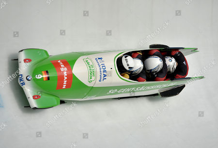 Germany's Thomas Florschuetz, Joshua Bluhm, Kevin Kuske and Christian Poser compete in the 4-Man Bobsled World Cup race in Winterberg, Germany, on . Florschuetz' team finished on the third place