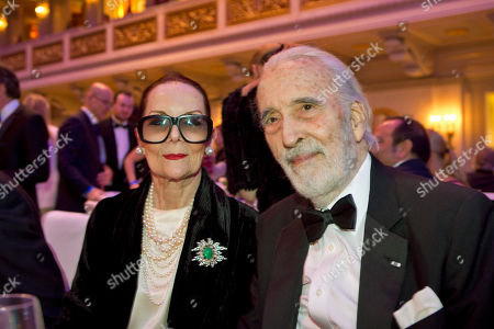 Actor Sir Christopher Lee, right, and Birgit Kroencke attend the Cinema For Peace fundraising gala in Berlin during the International Film Festival Berlinale