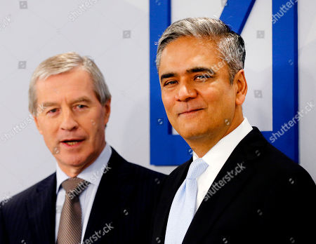 Anshu Jain, Juergen Fitschen FILE - In this Jan. 29, 2014 file picture CEOs of Deutsche Bank Anshu Jain, right, and Juergen Fitschen stand together prior to the annual press conference in Frankfurt, Germany. Deutsche Bank says it will pay 775 million euros US ($1.1 billion) plus interest and legal fees to settle a long-running dispute with the heirs of media mogul Leo Kirch. Kirch had accused the bank's former CEO Rolf Breuer of contributing to the eventual bankruptcy of his media group in a February 2002 television interview by implying that banks would not lend it any more money. Kirch died in 2011. Deutsche Bank's board rejected a settlement in 2012. Current co-CEOs Juergen Fitschen and Anshu Jain said it was now in the bank's best interest to put the matter behind it