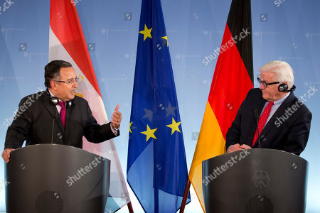 Stock Picture of German Foreign Minister Frank-Walter Steinmeier, right, and his Egyptian counterpart Nabil Fahmi, left, address the media during a news conference in Berlin, Germany