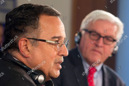 German Foreign Minister Frank-Walter Steinmeier, right, and his Egyptian counterpart Nabil Fahmi, left, address the media during a news conference in Berlin, Germany