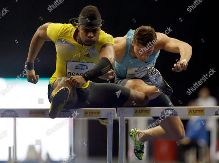 Oma Osaghae, left, from the United States runs to finish second, in the Men's 60 metre hurdles competition, during the ISTAF Indoor Athletics Meeting in Berlin, Germany, . At right is Germany's Erik Balnuweit
