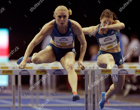 Sally Pearson, left, from Australia runs to win the Women's 60 metre hurdles competition at the ISTAF Indoor Athletics Meeting in Berlin, Germany, . At right is Germany's second placed Nadine Hildebrand
