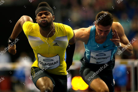 Oma Osaghae, left, from the United States runs to finish the Men's 60 metre hurdles competition in second place, during the ISTAF Indoor Athletics Meeting in Berlin, Germany, . At right is Germany's Erik Balnuweit