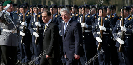 German President Joachim Gauck, right, welcomes the President of Malta, George Abela, left, with military honors for a meeting at the Bellevue palace in Berlin, Germany
