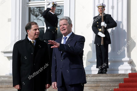 German President Joachim Gauck, right, and the President of Malta, George Abela, left, chat as they pose for the media prior to a meeting at the Bellevue palace in Berlin, Germany