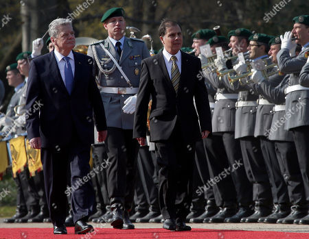 German President Joachim Gauck, left, welcomes the President of Malta, George Abela, right, with military honors for a meeting at the Bellevue palace in Berlin, Germany