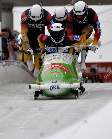 The German team with pilot Thomas Florschuetz, Joshua Bluhm, Kevin Kruske and Christian Poser compete in the 4 Man Bob World Cup in Winterberg, Germany, on
