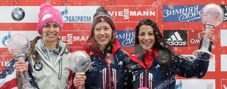 Winner Elizabeth Yarnold of Britain, center, celebrates with the overall world cup trophy besides second placed Noelle Pikus-Pace of the United States, left, and third placed Shelley Rudman of Britain during the overall world cup ceremony at the women's Skeleton World Cup race in Koenigssee, southern Germany, on